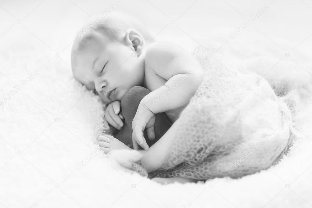 Newborn Girl Is Sleeping With Heart Sleeping Time Stock Photo