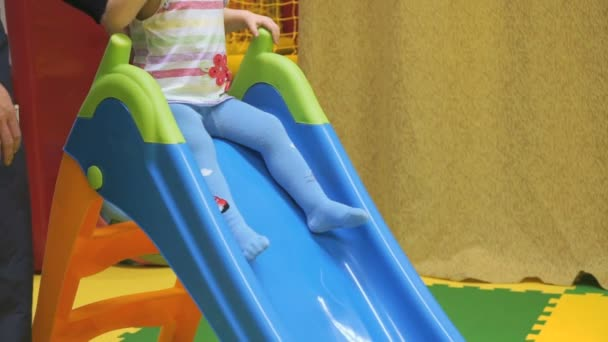 Child is riding with childrens plastic slides