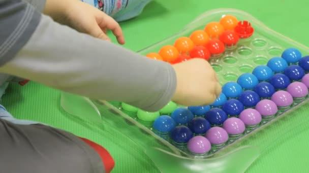 Child plays intellectual games in kindergarten