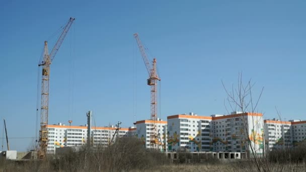 Construction cranes work on construction site