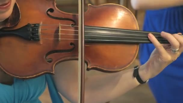 Close-up of a woman playing the violin