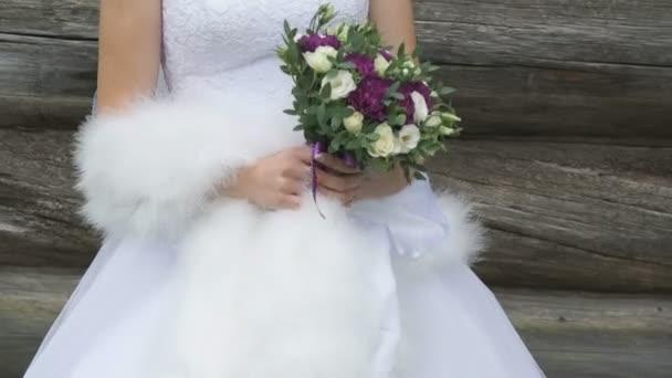 Beautiful bride holding a wedding bouquet