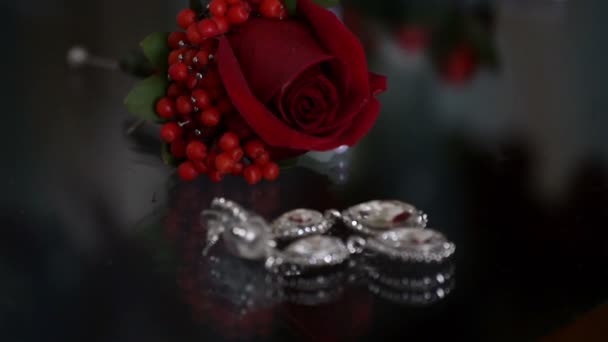 Still life with a rose and a jewellery