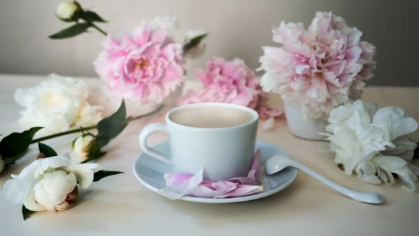 fresh cappuccino in the white cup, still life with peonies. HD cinemagraph - motion photo seamless loop