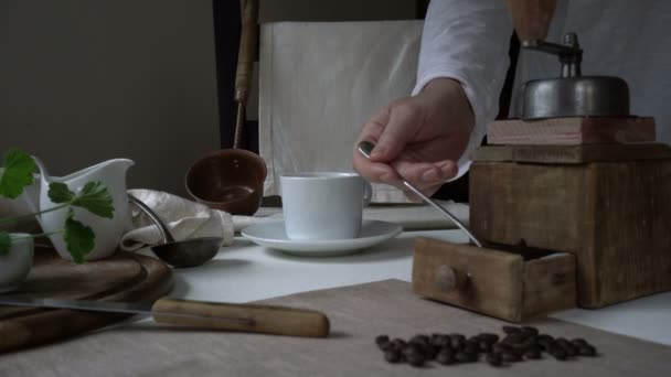 rustic still life. preparing coffee. womans hand falls asleep ground coffee into a cup
