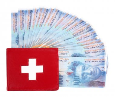 Swiss francs banknotes and red wallet with Swiss flag
