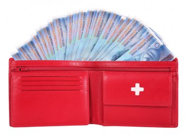 Swiss francs in red wallet