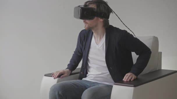 Man Wearing Virtual Reality Glasses Watching Movies or Playing Video Games.  VR Headset technology concept.