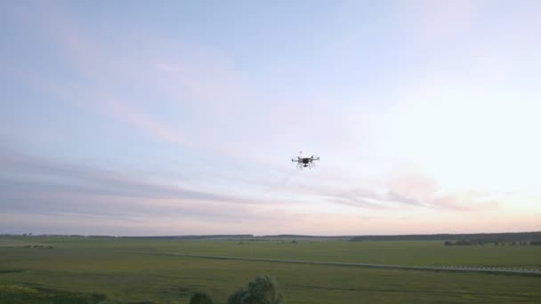 Flying drone above the field