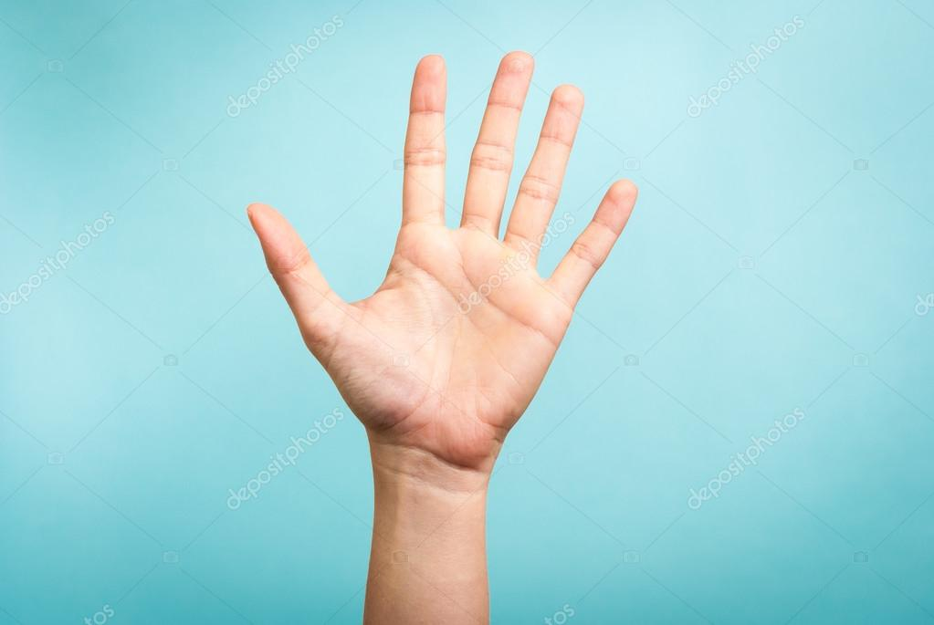 woman hand up gesturing high five stop concept on blue background