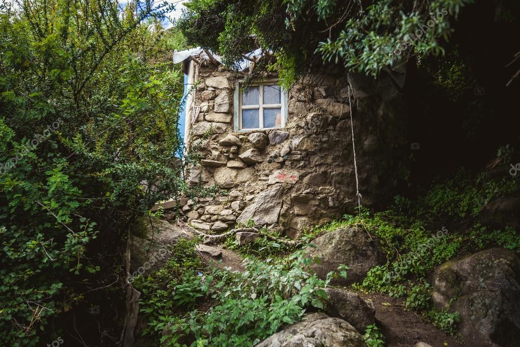 Tiny Stone House In The Woods Stock Photo