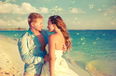 Happy newlyweds on seashore