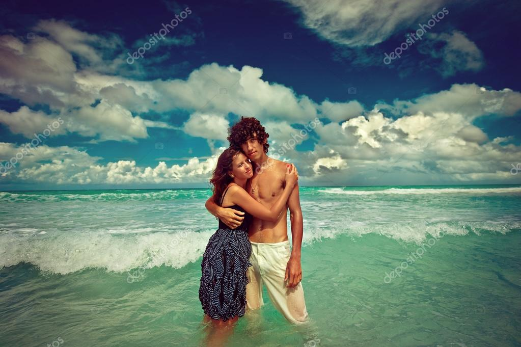 couple in love over ocean