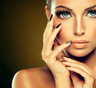 female model with  golden make-up