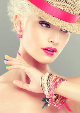 girl with colorful manicure