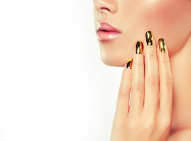 hand with golden nails