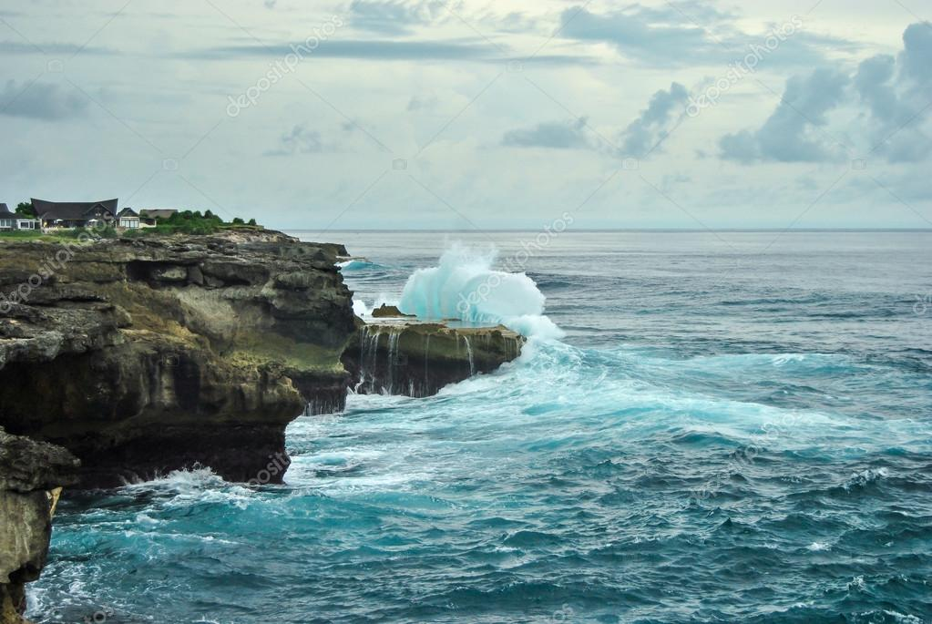 Waves breaking on the rocks. Devil's tear, Nusa Lembongan, Indonesia