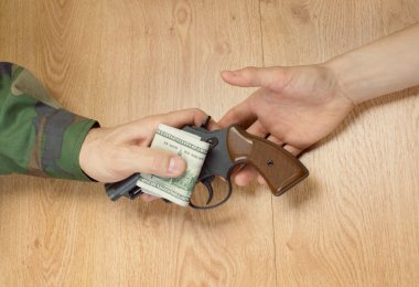 Transfers of money in exchange for a gun under certain condition