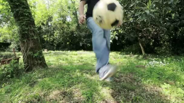 Soccer player juggling ball