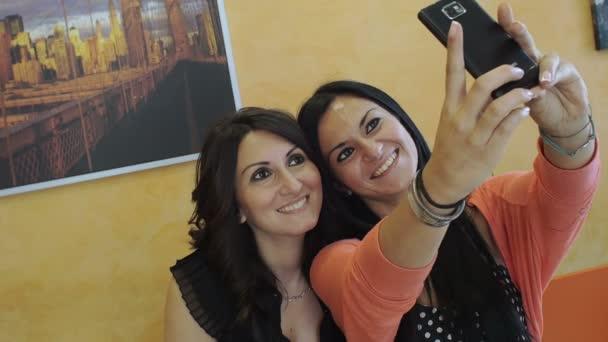 smiling businesswomen making photos