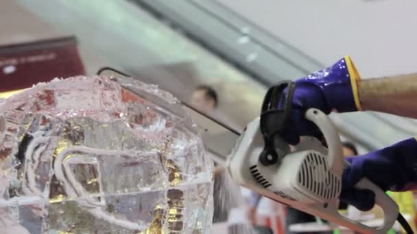 Ice sculptor modeling a helmet for motorcycle