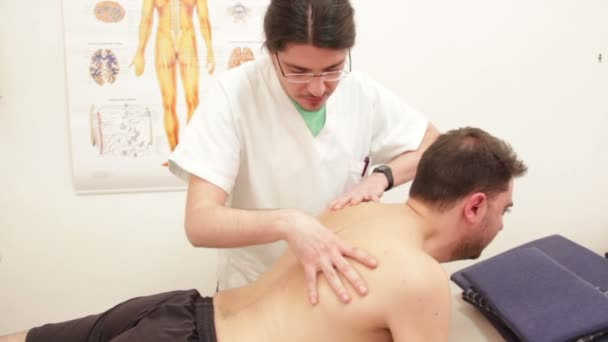 Physiotherapist examing patient