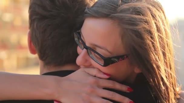 Girl hugging her boyfriend outside