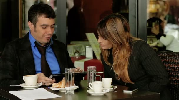 Business meeting. Businesswoman and businessman in cafe, talking.