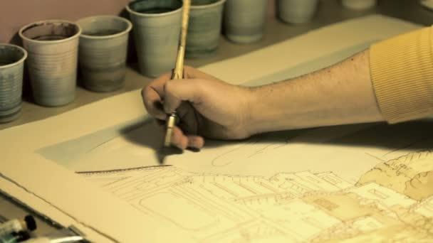 Profesionální umělec pracující na krajinu