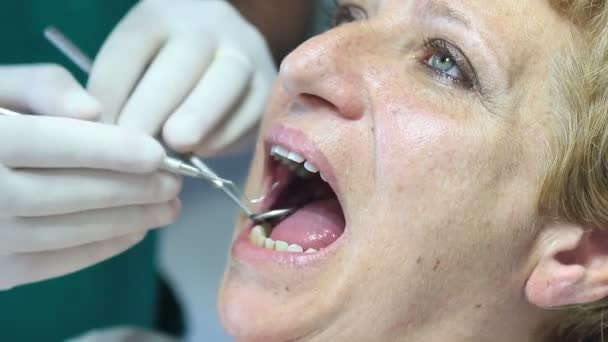 Dentist equipment - Female teeth being checked by doctor