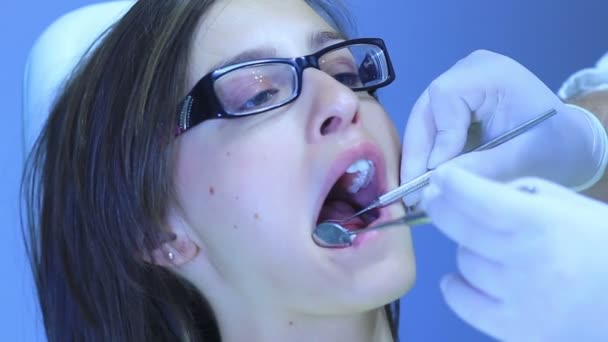 Dentist - Close-up of patient (young girl) open mouth during oral checkup