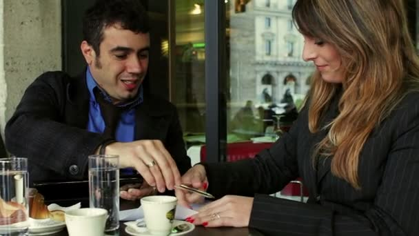 Business partners signing contract. Business people sitting in a cafe