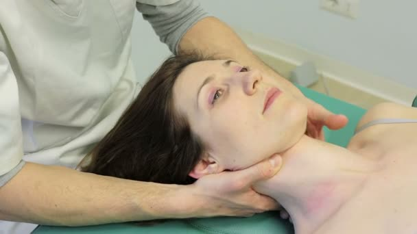 a girl was examined  by physiotherapist on examination table. Part examinated was neck and head
