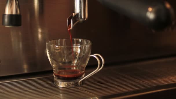 machine pouring coffee into a cup