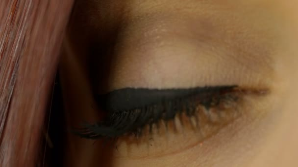 young woman eye: cute woman opens her eye