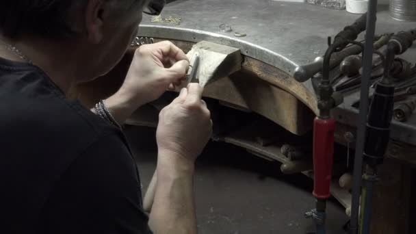 Goldsmith is refining a gold ring