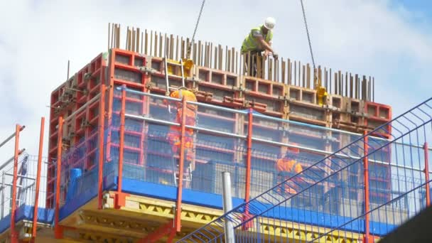 workers in a construction site in the city centre working on the scaffolds