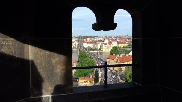 Prague: crowd of tourist on the Vitava river over the Charles Bridge