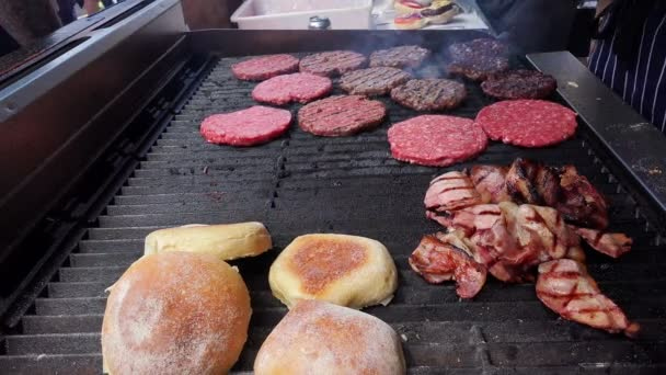 Burger shop - hamburgers with bacon and bread on grill
