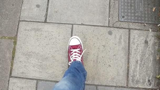 POV - Feet walking on the street with red shoes