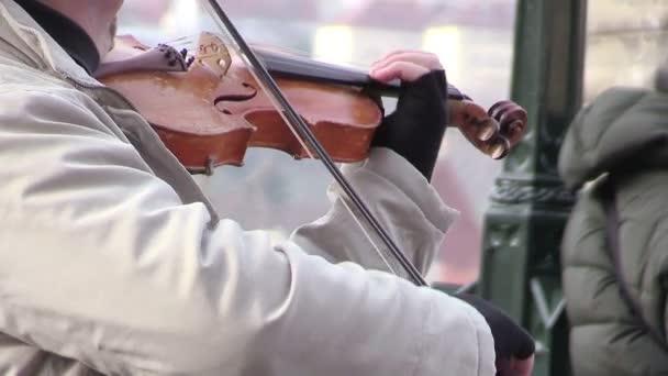 street artist playing violin in Prague