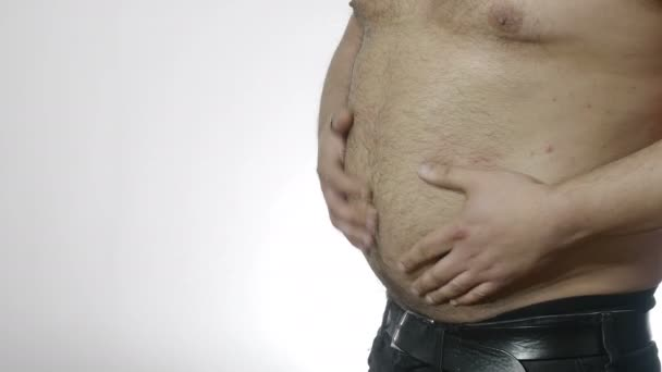 young overweight man playing and touching his fat belly