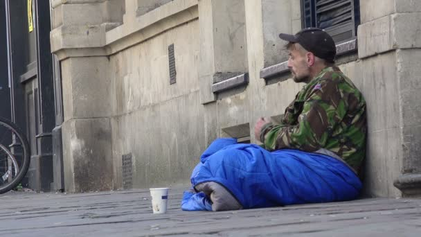 homeless man waiting for charity in the street