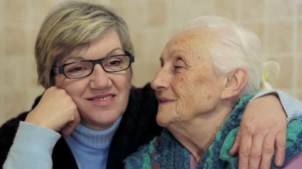 Family love: old grandmother kiss her daughter