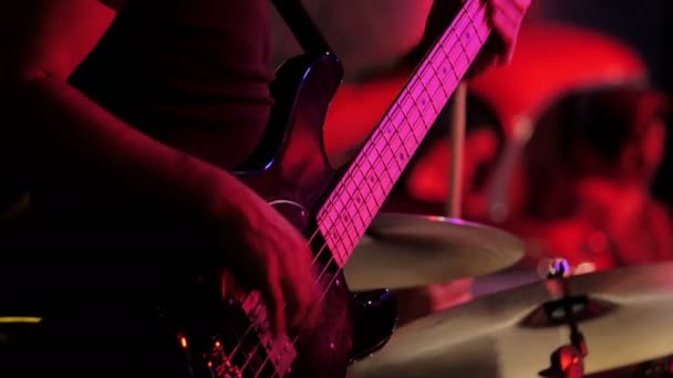 guitar and drums during a small concert