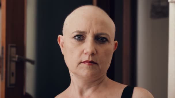 hope, strength - sick bald woman looking at camera and smiling . indoor