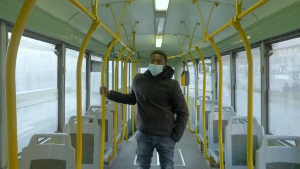 pandemic, 2021 - black man with mask on a deserted bus because of the covid