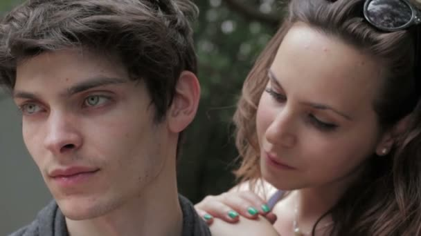 beautiful young man kissing his girlfriend on the forehead