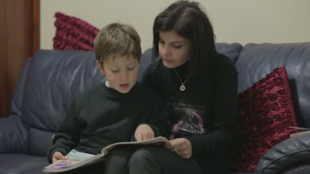Mom is reading a book with her young son