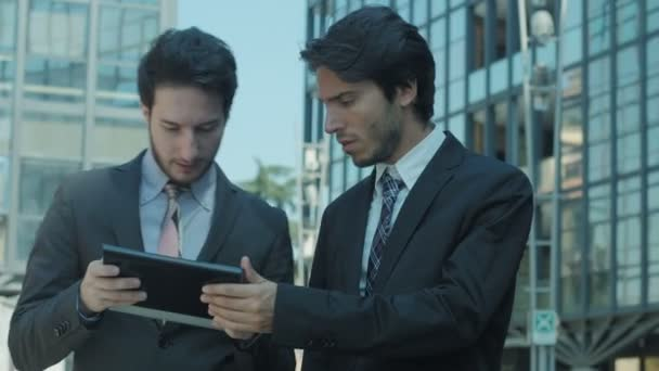businesspeople monitor their work away from the office: tablet, computer, ipad